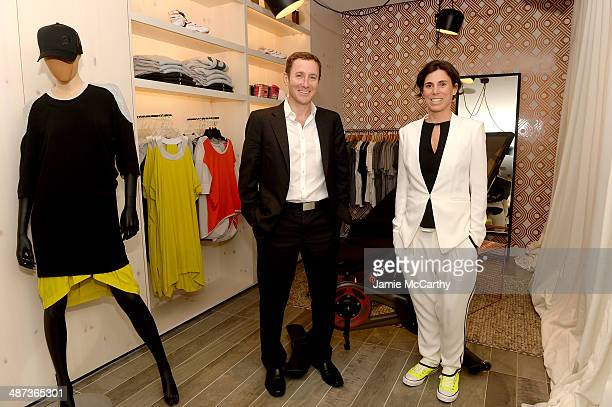 Co-Founder and CEO, John Foley and co-founder Marion Roaman attend the Peloton's Launch Party For Flagship Spin Studio In NYC on April 29, 2014 in...