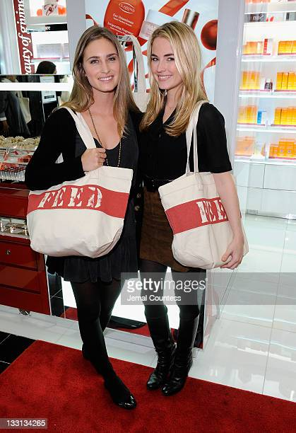 CoFounder and CEO of FEED Projects Lauren Bush Lauren and Amanda Hearst pose for a photo at the Bloomingdale's 59th Street Store to support Clarins...