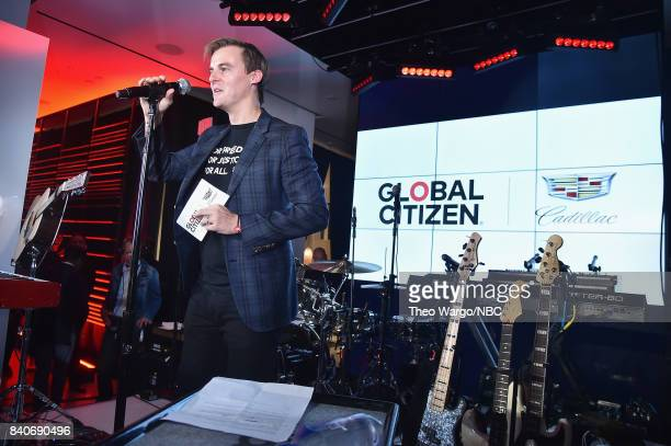CoFounder and CEO of Global Citizen and Global Poverty Project Hugh Evans speaks onstage during the Global Citizen and Cadillac Present The...