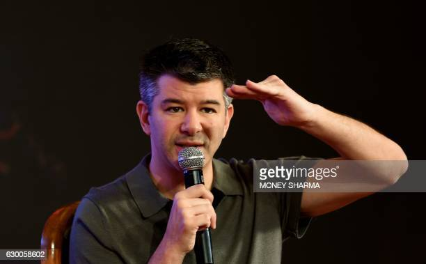 Cofounder and Chief Executive Officer of US tranportation company Uber Travis Kalanick gestures as he speaks at an event in New Delhi on December 16...