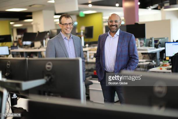 Cofounder and cochairman Steve Conine left and CEO cofounder and cochairman Niraj Shah pose for a portrait at their desks surrounded by their...