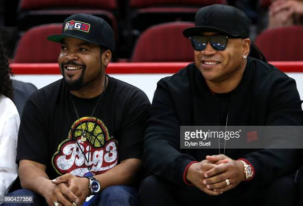 CoFounder and entertainer Ice Cube sits with rapper LL Cool J during week two of the BIG3 three on three basketball league at United Center on June...