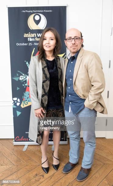 AWFF Cofounder and Managing Director Asel Sherniyazova and Writer/Director Sam Kadi attend a reception as Angelina Jolie Accepts the Rising Star...