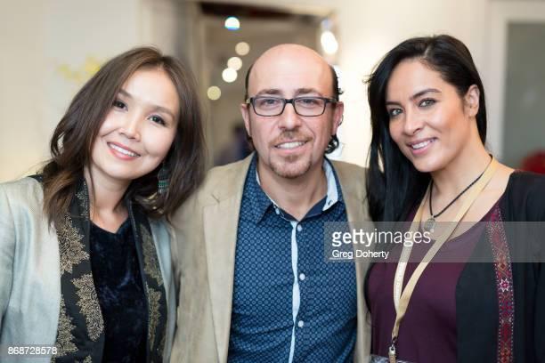 AWFF Cofounder and Managing Director Asel Sherniyazova Writer/Director Sam Kadi and Majia Khaan attend a reception as Angelina Jolie Accepts the...