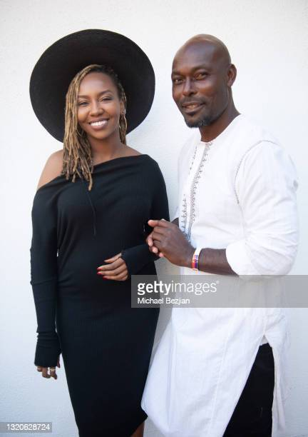 Co-founder of Black Lives Matter Opal Tometi and Jimmy Jean-Louis pose for a portrait at The Artists Project Giveback Day on May 28, 2021 in Los...