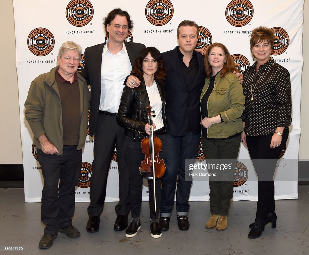 Co-founder of Carter Vintage Guitars Walter Carter, Senior Director, Producer and Writer at the Country Music Hall of Fame and Museum Peter Cooper, Amanda Shires, Jason Isbell, co-founder of Carter Vintage Guitars Christie Carter, and Senior VP of Sales and Marketing at the Country Music Hall of Fame and Museum Sharon Brawner attend the kick off of Jason Isbell's sold out residency at the Country Music Hall of Fame and Museum with Wife Amanda Shires on December 5, 2017 in Nashville, Tennessee.