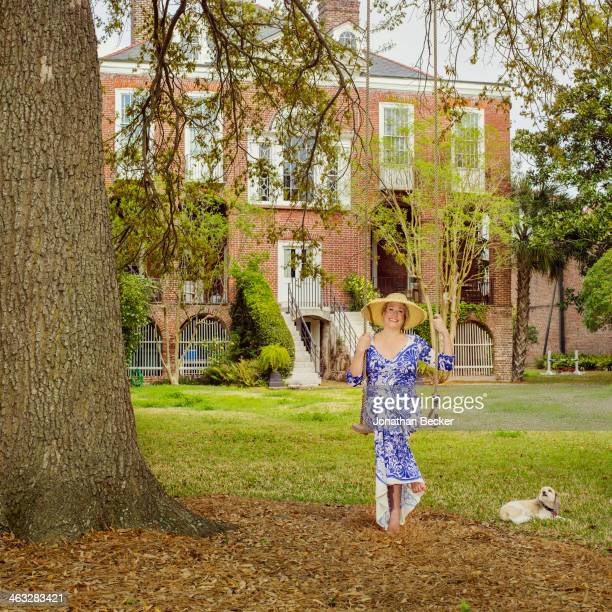 Cofounder of Charleston Academy of Domestic Pursuits Lee Manigault is photographed with dog Scout for Town Country Magazine on April 11 2013 at home...