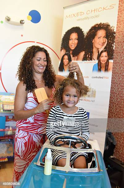 Cofounder of Mixed Chicks Wendi Kaaya styles hair at the Mixed Me Book Launch Multiculti Mixer on October 22 2015 in Los Angeles California