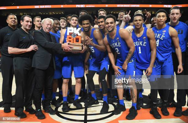 Cofounder of Nike Phil Knight presents the Duke Blue Devils the championship trophy for the Motion Bracket' of the PK80Phil Knight Invitational...