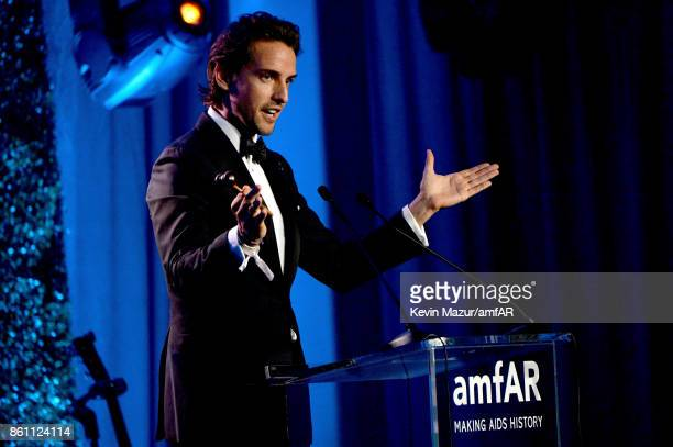 CoFounder of Paddle8 Alexander Gilkes speaks onstage during the amfAR Gala Los Angeles 2017 at Ron Burkle's Green Acres Estate on October 13 2017 in...