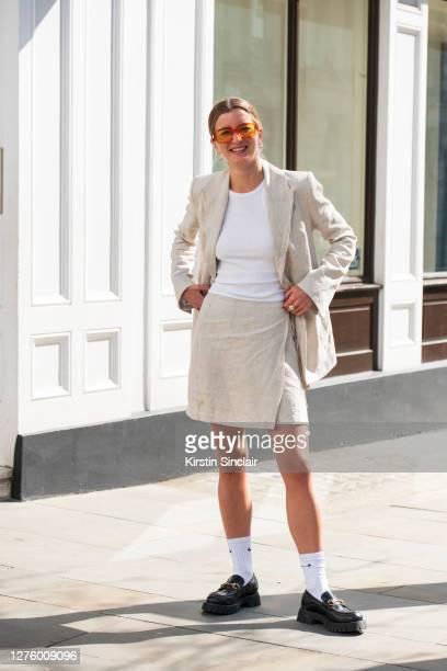 Co-Founder of Rotaro Georgie Hyatt wears Gucci shoes, Nike socks, Topshop top, Han Kjobenhavn and a Jillian Boustred suit during LFW September 2020...