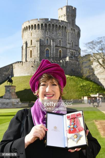 Cofounder of the Ambassador Theatre Group Limited Rosemary Squire poses with her medal after being appointed a Dame Commander of the Order of the...