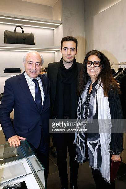 CoFounder of the Store JeanVictor Meyers standing between his parents JeanPierre Meyers and Francoise Bettencourt Meyers attend the Opening of the...