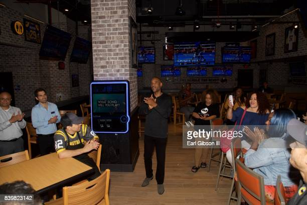 CoFounder PCF Restaurant Management Karim Webb speaks to the crowd of attendees at the Buffalo Wild Wings Opening In Koreatown at Buffalo Wild Wings...