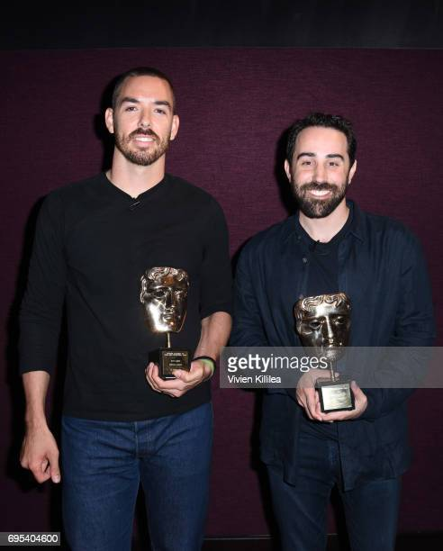 Co-founders and co-CEOs of Riot Games Marc Merrill and Brandon Beck pose with their awards at BAFTA Honours Riot Games with Special Award at The...
