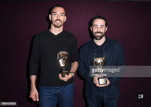 Cofounders and coCEOs of Riot Games Marc Merrill and Brandon Beck pose with their awards at BAFTA Honours Riot Games with Special Award at The London...