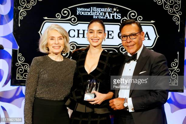 CoFounders Felix Sanchez and Merel Julia present an award to actress Melissa Barrera at the National Hispanic Foundation for the Arts' 23rd Annual...
