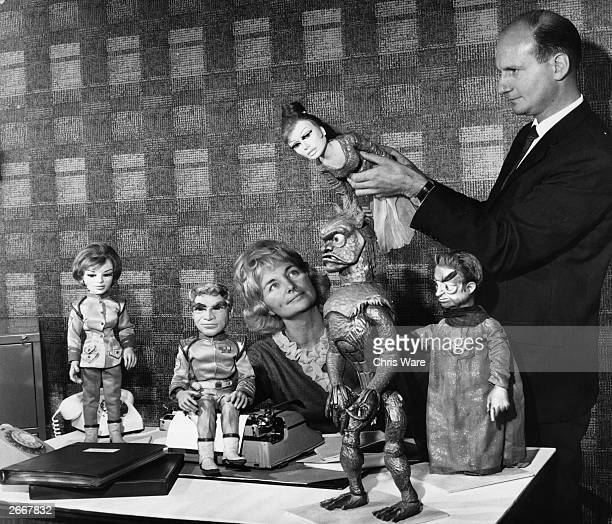 Cofounders of a TV puppet adventure series 'Stingray' Gerry and Sylvia Anderson with some of the 'cast'