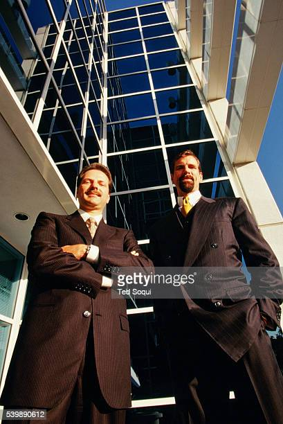 Cofounders of Broadcom Henry Samueli and Henry T Nicholas stand in front of Broadcom headquarters They are both indicted on federal charges including...