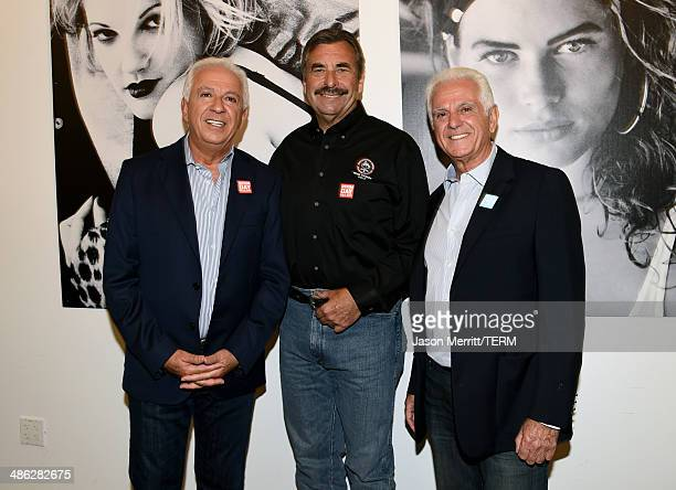 Cofounders of Guess Inc Paul Marciano and Maurice Marciano with Chief of LAPD Charlie Beck attend the GUESS and Peace Over Violence celebration of...