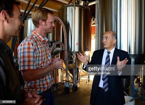 Cofounders of the Denver Beer Company Patrick Crawford left and Charlie Berger center give Japanese Ambassador Kenichiro Sasae a tour of their...