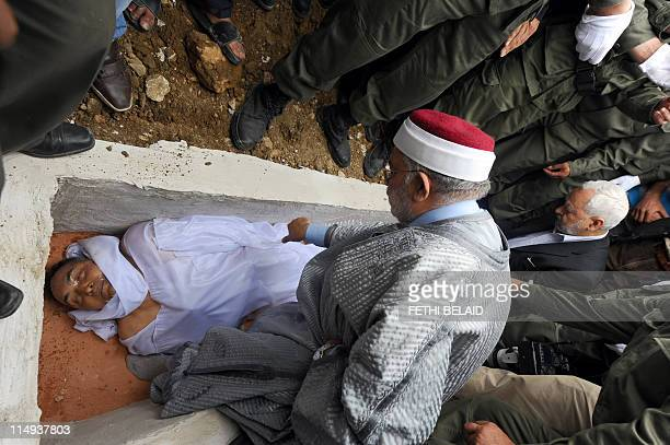 Cofounders of the Islamist movement Ennahada or EnNahdha Abdelfattah Mourou and Rached Ghannouchi stand in the coffin of Tunisian Colonel Taher...