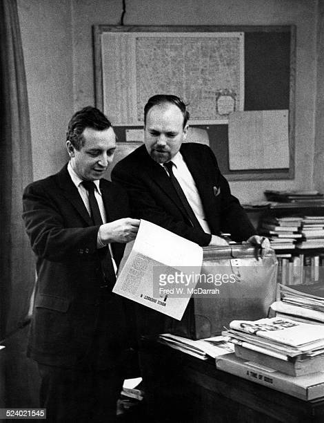 Cofounders of the Village Voice newspaper Dan Wolf and Ed Fancher review copy in the paper's offices New York New York November 2 1962