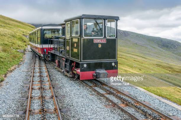 cog gear train for passengers on mount snowdon in wales - mount snowdon stock photos and pictures