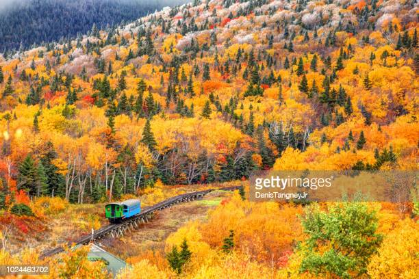 cog railway train climbing mt washington - new hampshire stock pictures, royalty-free photos & images