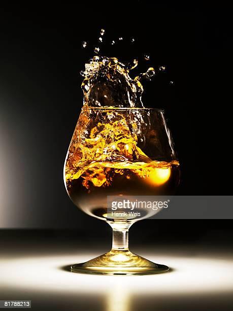 cognac splash - brandy stock pictures, royalty-free photos & images