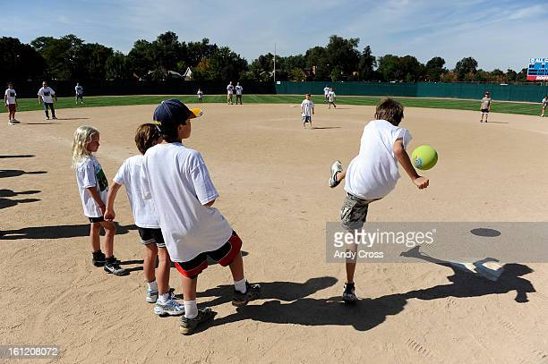 DENVER COGriffen Rollert 11yearsold right kicks the ball into play during the 3rd annual McKaila Ball a kickball party at the Colorado Rockies...