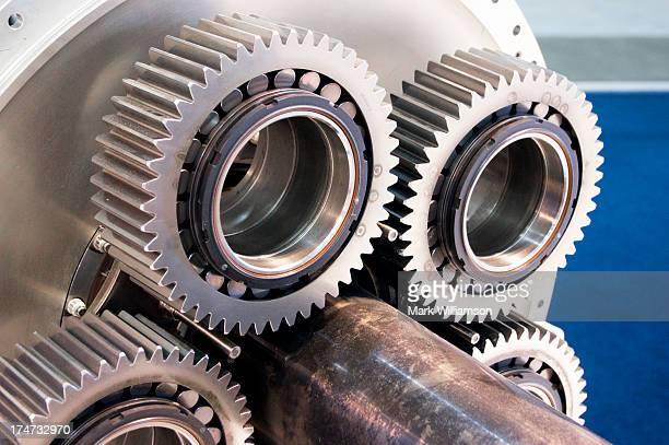 Cogs and roller bearings.