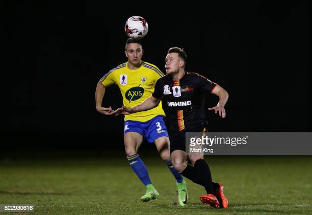 Cohan Morris of the MetroStars is challenged by Daniel Di Ruocco of the Bankstown Berries during the FFA Cup round of 32 match between Bankstown...