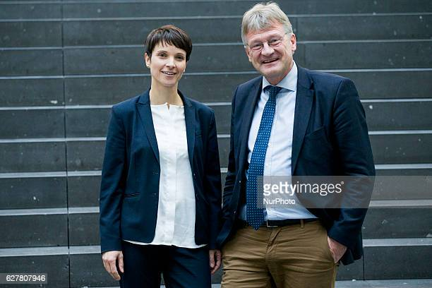 Coheads of the Alternative fuer Deutschland political party Frauke Petry and Joerg Meuthen pose for a picture prior to a news conference about an...