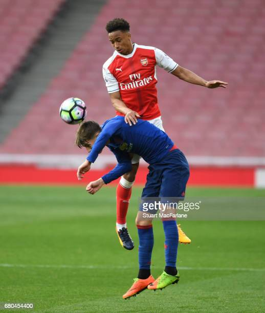 Cohen Bramall of Arsenal challenges Callum Gribbin of Man United during the Premier League 2 match between Arsenal and Manchester United at Emirates...
