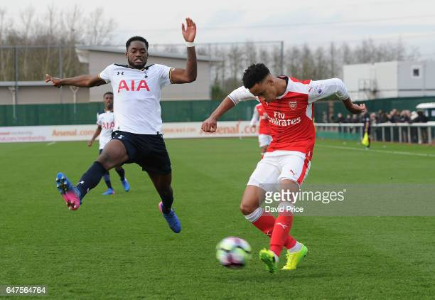 Cohen Bramall of Arsenal crosses under pressure from Christian Maghoma of Tottenham during the match between Arsenal U23 and Tottenham Hotspur U23 at...