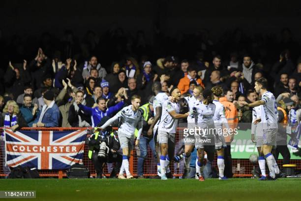 Cohen Bramall of Colchester United celebrates after scoring his team's second goal with his team mates during the Carabao Cup Round of 16 match...