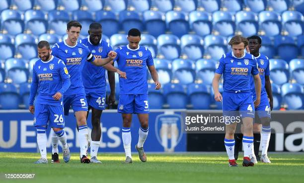 Cohen Bramall of Colchester United celebrates with teammates after scoring his sides first goal from a free-kick during the Sky Bet League Two Play...