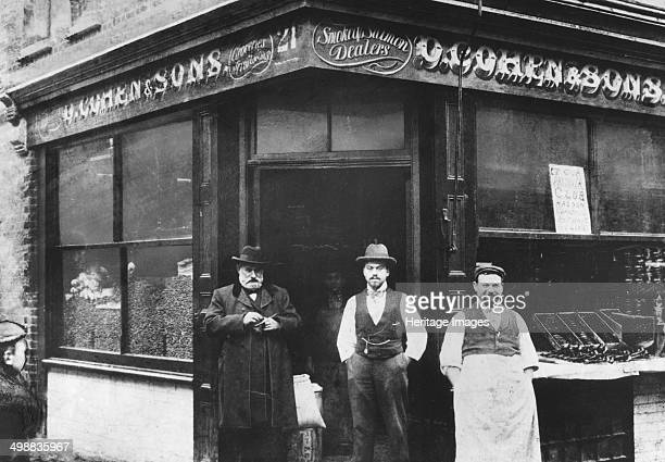 Cohen Sons grocers and smoked salmon dealers East End of London c1890 Mr Davis Cohen with Moses and Jacob two of his four sons outside their shop...