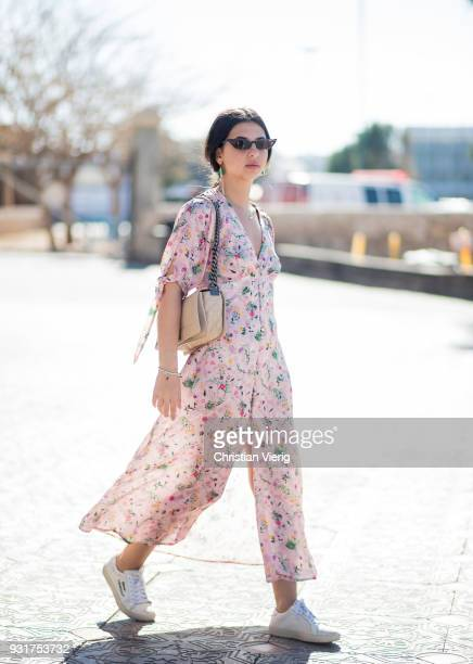 Cohen wearing dress with floral print sneakers is seen during Tel Aviv Fashion Week on March 13 2018 in Tel Aviv Israel