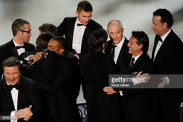 Cohost Alec Baldwin actors Guy Pearce Anthony Mackie Brian Geraghty cinematographer Barry Ackroyd and presenter Tom Hanks celebrate Best Picture...