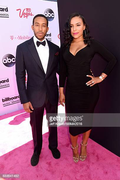 Cohost Chris 'Ludacris' Bridges and Eudoxie Mbouguiengue attend the 2016 Billboard Music Awards at TMobile Arena on May 22 2016 in Las Vegas Nevada