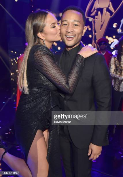 Cohost Chrissy Teigen and John Legend pose onstage during Lip Sync Battle Live A Michael Jackson Celebration at Dolby Theatre on January 18 2018 in...