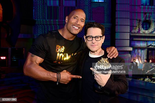 Cohost Dwayne Johnson and director JJ Abrams winner of the Movie of the Year award for 'Star Wars The Force Awakens' pose during the 2016 MTV Movie...