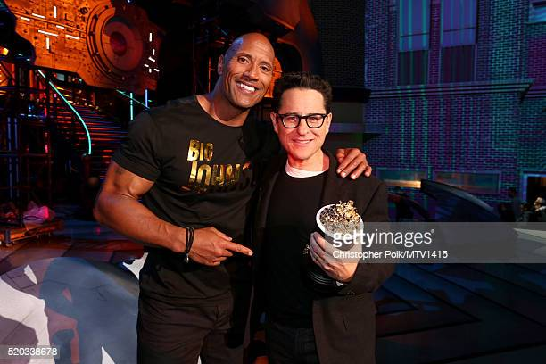 Cohost Dwayne Johnson presents the award for Movie of the Year for 'Star Wars The Force Awakens' to director/producer JJ Abrams onstage during the...