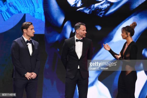 Cohost Kate Abdo and New Laureus Academy member Francesco Totti and Ryan Giggs during the 2018 Laureus World Sports Awards show at Salle des Etoiles...