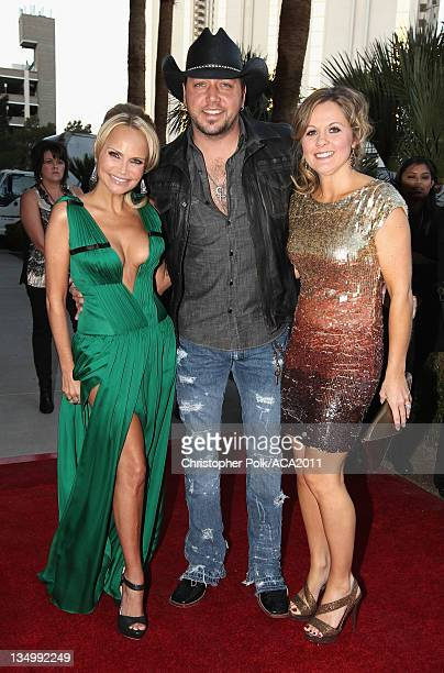 Co-Host Kristin Chenoweth, musician Jason Aldean, and Jessica Aldean arrive at the American Country Awards 2011 at the MGM Grand Garden Arena on...