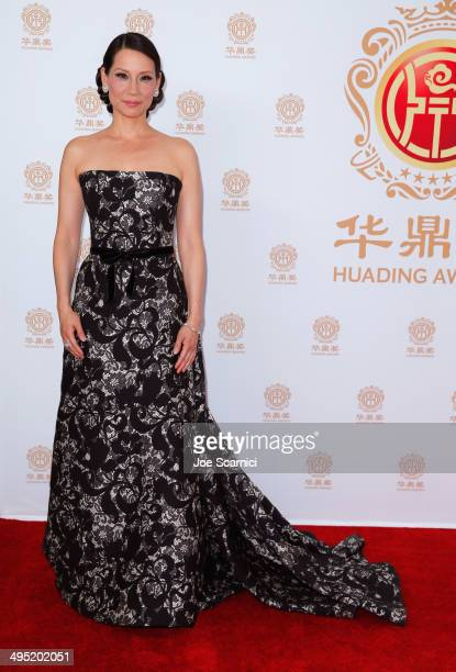 Cohost Lucy Liu poses in the press room during the Huading Film Awards on June 1 2014 at Ricardo Montalban Theatre in Los Angeles California Huading...