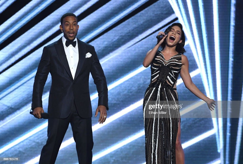 Co-host Ludacris (L) looks on as co-host Vanessa Hudgens sings during the 2017 Billboard Music Awards at T-Mobile Arena on May 21, 2017 in Las Vegas, Nevada.