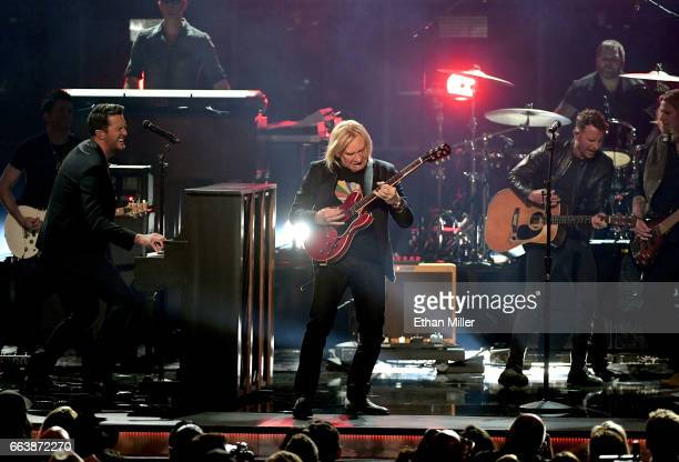 Cohost Luke Bryan recording artist Joe Walsh and cohost Dierks Bentley perform onstage during the 52nd Academy of Country Music Awards at TMobile...